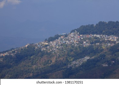 DARJEELING, INDIA -DEC 02 : View of the densely packed dwellings along the hills  on December 02, 2018 in Darjeeling, West Bengal, India. Darjeeling a popular hill station in North East India.