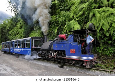 DARJEELING, INDIA, - July. 8. 2012: Darjeeling Himalayan Railway or Toy Trainon, famous tourist attraction, it has been UNESCO World Heritage Site since 1999