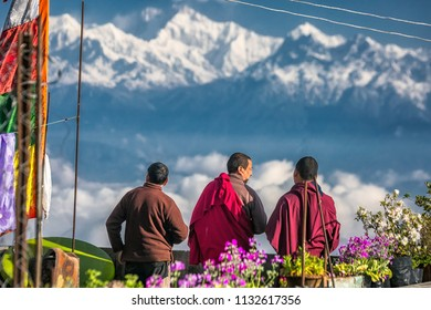 DARJEELING, INDIA - MARCH 21, 2017: Close up of buddhist monks on a mountains background in Darjeeling, India.