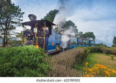 DARJEELING, INDIA - NOVEMBER 27, 2016: steam engine hauled DHR Toy Train has been operating on 2-foot gauge tracks since 1880s and gained the UNESCO World Heritage status.