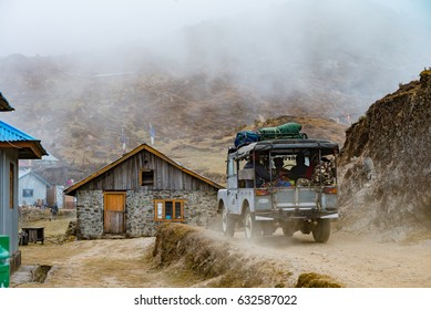 DARJEELING, INDIA - NOVEMBER 29, 2016: a tourist jeep passes through Singalila National Park.  It is the route to Sankakphu and Phalut, the two highest peaks of Singalila range.