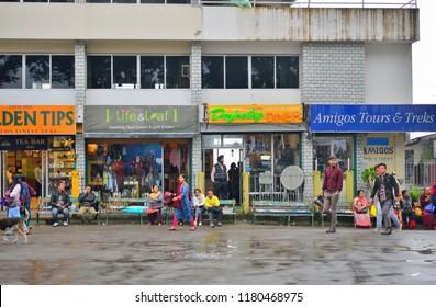 Darjeeling, India - September 01, 2018: Colorful shops in the popular mall road in Darjeeling.