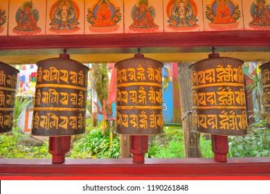 Darjeeling, India - September 02, 2018: Tibetan prayer wheels at Mahakal temple in Darjeeling.