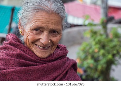 Darjeeling. West Bengal. India. 29 May, 2017. Documentary. Portrait of unidentified local woman smiling on the street.