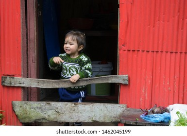 Darjeeling, West Bengal - July 19 2019: A little Nepali boy child at the doorstep of their house in the hills.