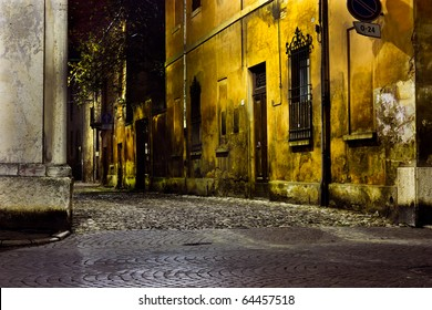 dark alley at night, narrow dirty corner, street  in the old town