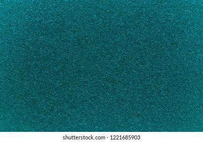Dark Arcadia granular texture background. Green-blue color.
