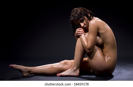 dark artistic nudity picture of wet naked woman