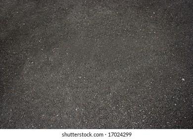 Dark asphalt texture detail