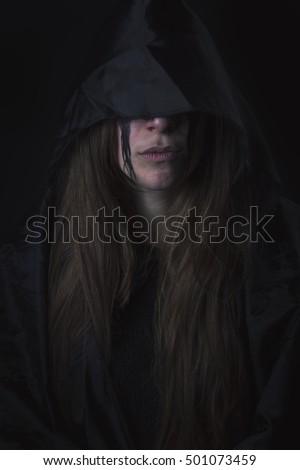 Dark assassin woman hidden
