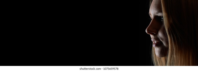 Dark background banner with young woman in profile