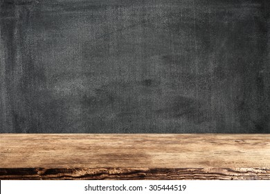dark background of black board and dark brown shabby desk top