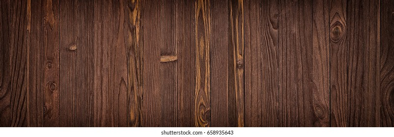 dark background of brown boards, wood grain table