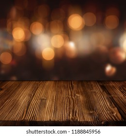 Dark background with celebratory golden bokeh and empty wooden table for a oktoberfest decoration