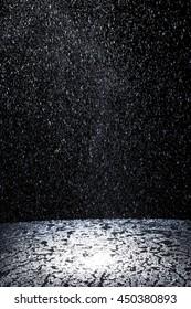 Dark background shot of rain falling