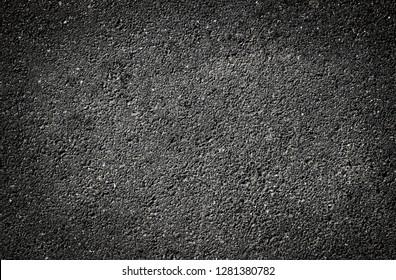 Dark background texture of asphalt