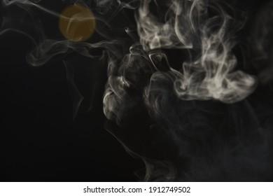 Dark Background of White Swirling Smoke and Light Leak Bokeh