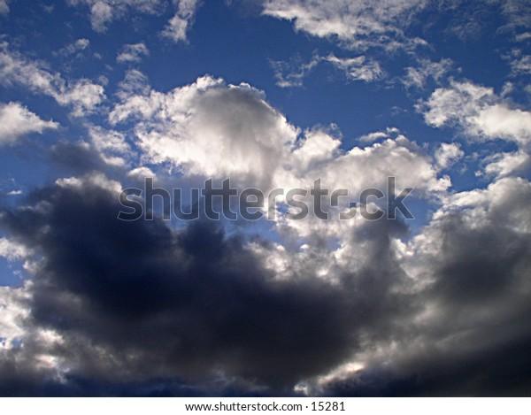 Dark backlit clouds