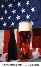Dark beer on the American flag