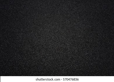 Dark black asphalt surface, background