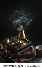 Dark black background turkish coffee cup turk aroma beans hot smoke steam coffee