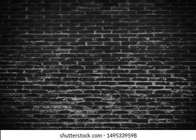 dark black brick wall surface texture for background.