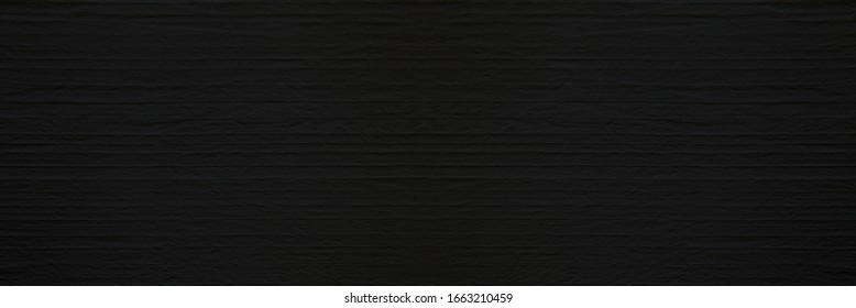 Dark black concrete wall with rustic natural texture for abstract background texture and design purpose