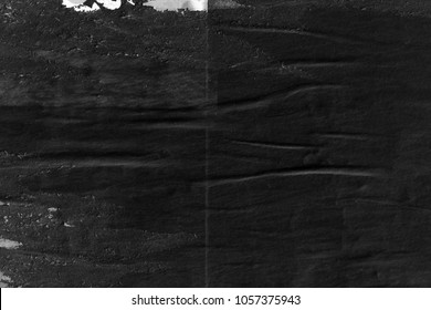 Dark black grey paper background creased crumpled surface old torn ripped posters placard grunge textures