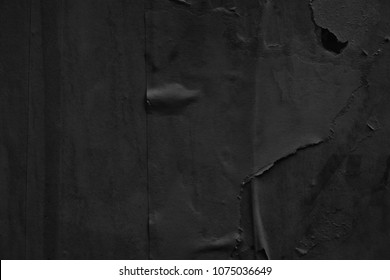 Dark black grey paper background creased crumpled surface / Old torn ripped posters scary grunge textures