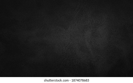 dark black leather texture closeup with detailed background. black abstract uneven grunge background texture of interior classic chamois leather fabric.