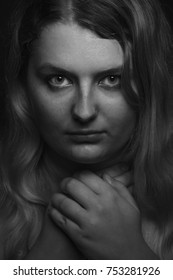 Dark black an white portrait of a young woman