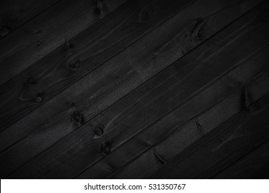 Dark black wood background or texture of plank