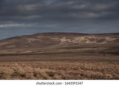 Dark, bleak, desolate Scottish grouse moor in mid winter. Scottish Highlands.
