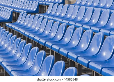 Dark blue armchairs at stadium. The tool of struggle of fans.