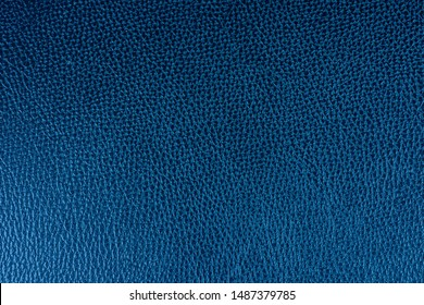 Dark blue artificial leatherette for background. Fabric navy leather texture.  top view.