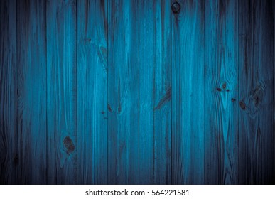 Dark blue background tree textured. Front view with empty spase. Vertical boards.