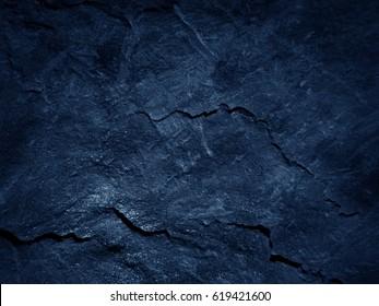 Dark blue black slate background or texture.