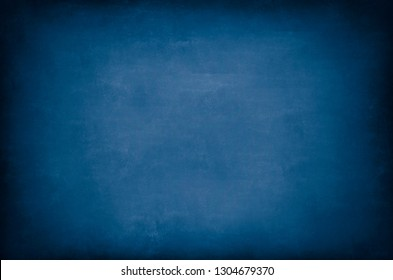 Dark Blue Blackboard. Messy scratchy chalkboard texture as background.