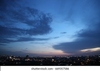 dark blue cloud with white light sky background and city light midnight evening time