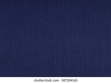 Dark blue coarse woven fabric abstract background texture showing warp and weft