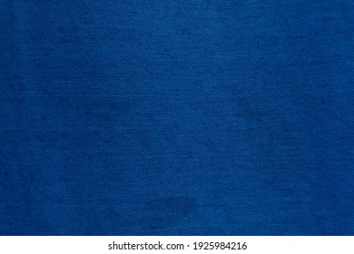 Dark Blue denim fabric texture background, the strong cotton cloth used especially to make jeans.