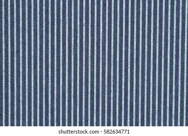 Dark blue denim with teal stripes fabric background