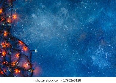 Dark blue distressed texture with glowing lights. Christmas background