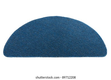 A dark blue doormat for cleaning feet before come in a house