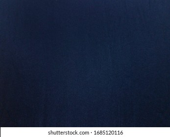 Dark blue fabric texture for background or wallpaper.