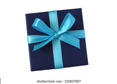 Dark blue gift box with light blue bow - top view - isolated on white background