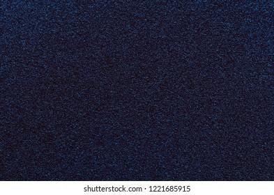 Dark blue granular texture background similar to space.