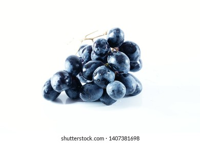 Dark blue grape isolated on a white background