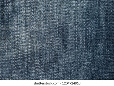 Dark blue jeans fabric for men's trousers with vertical strip firmware.