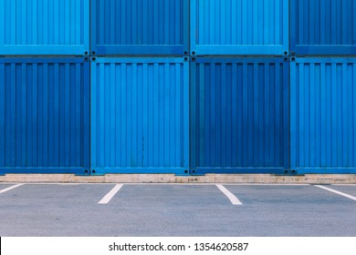 Dark blue and light blue containers and parking spots